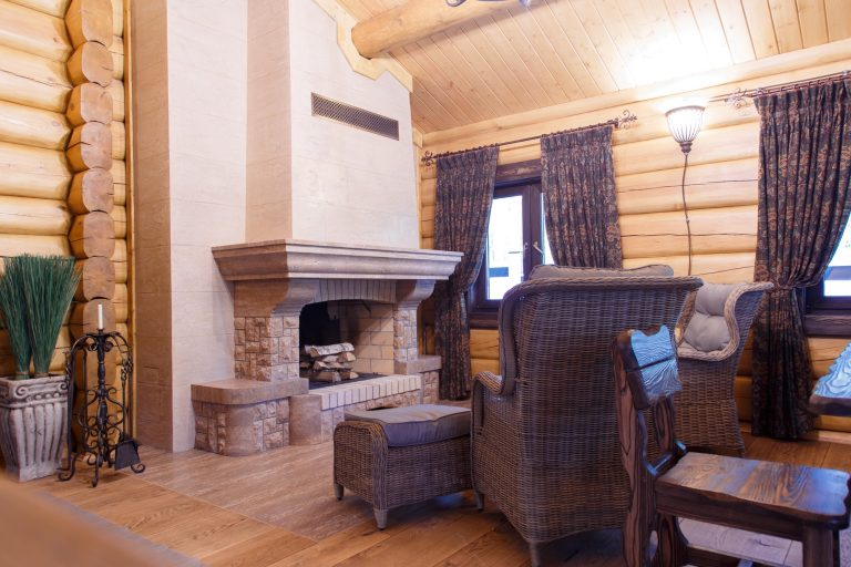 chimney room interior in private house built of logs.